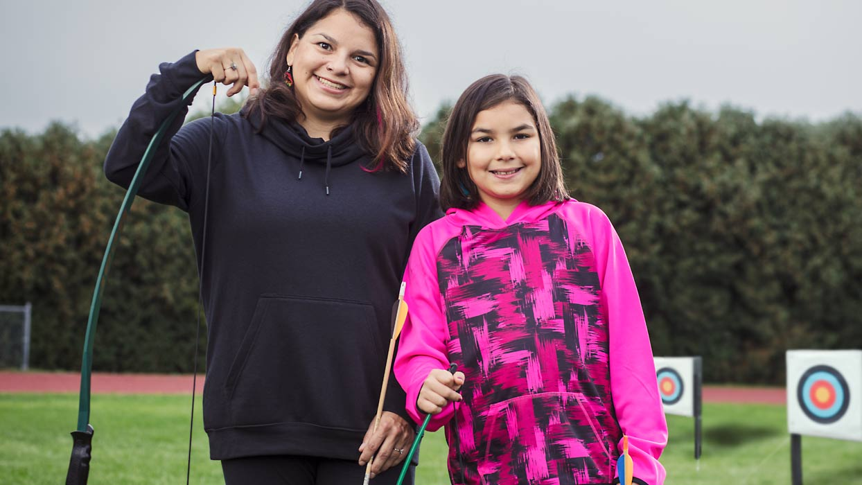 Mother with daughter at archery